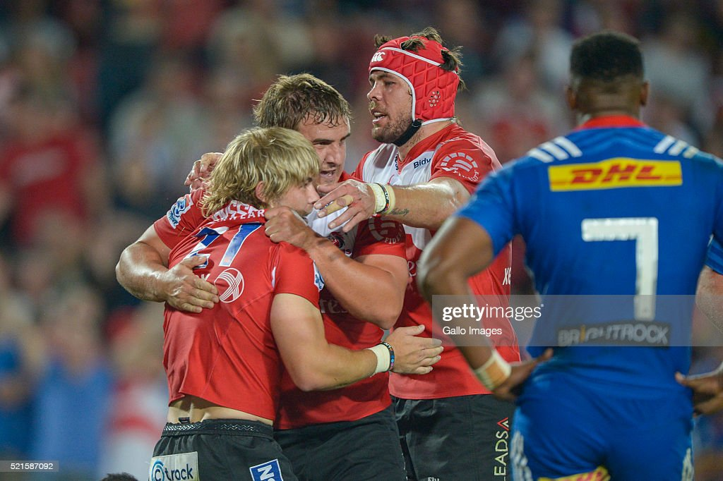 Faf de Klerk of the Lions celebrates a try with team mates during the 2016 Super Rugby match between Emirates Lions and DHL Stormers at Emirates Airline Park on April 16, 2016 in Johannesburg, South Africa.