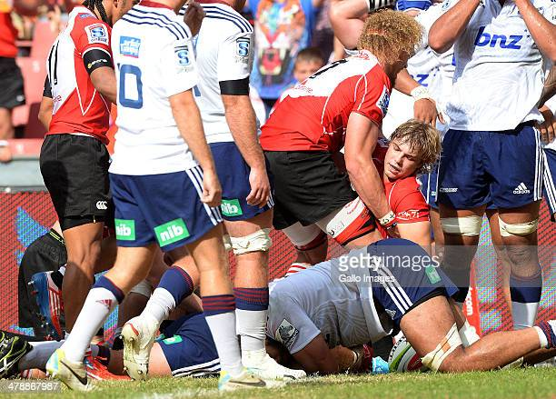 Faf de Klerk of the Lions celebrates his try during the Super Rugby match between Lions and Blues at Ellis Park on March 15 2014 in Johannesburg...