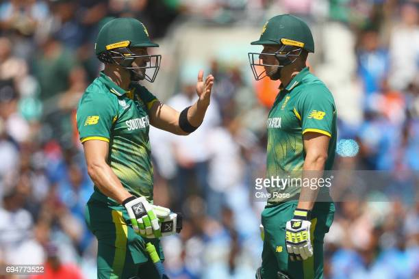 Faf du Plessis and David Miller of South Africa look on after the running out David Miller during the ICC Champions trophy cricket match between...