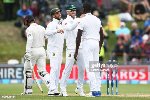 Faf du Plessis and Kagiso Rabada of South Africa celebrate the dismissal of Kane Williamson of New Zealand during day three of the First Test match...