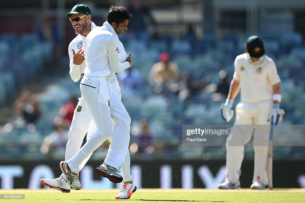 Faf du Plessis and Keshav Maharaj of South Africa celebrate after defeating Australia during day five of the First Test match between Australia and South Africa at the WACA on November 7, 2016 in Perth, Australia.