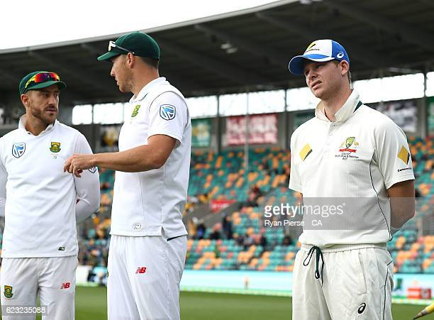 Faf du Plessis and Kyle Abbott of South Africa look on with Steve Smith of Australia during day four of the Second Test match between Australia and...