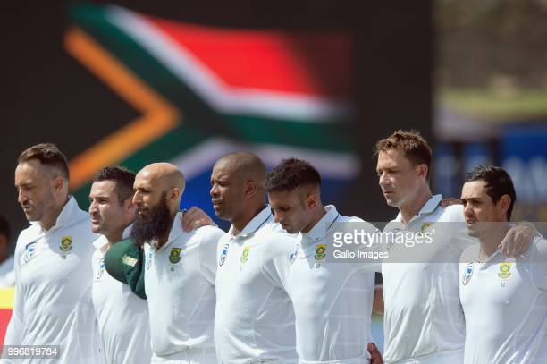 Faf du Plessis Dean Elgar Hashim Amla Vernon Philander Keshav Maharaj Dale Steyn and Quinton de Kock of South Africa sings the national anthem prior...