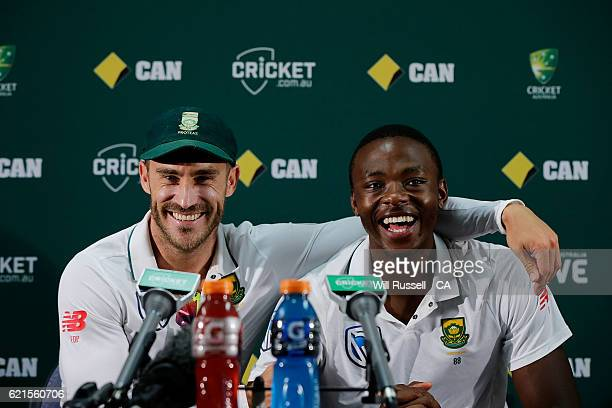 Faf du Plessis embraces Kagiso Rabada of South Africa at the press conference after defeating Australia during day five of the First Test match...