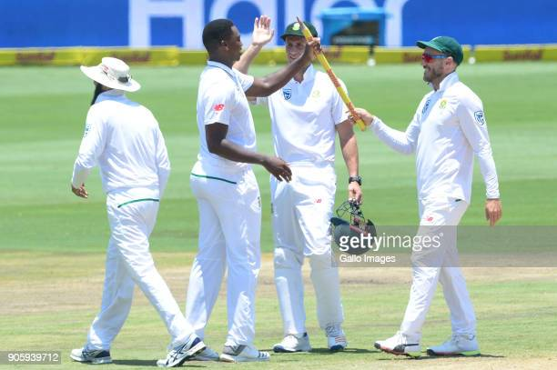 Faf du Plessis hands a stump to Lungi Ngidi of the Proteas after taking 6 wickets for 39 runs during day 5 of the 2nd Sunfoil Test match between...
