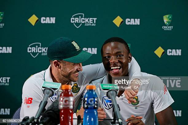 Faf du Plessis hugs Kagiso Rabada of South Africa at the press conference after defeating Australia during day five of the First Test match between...
