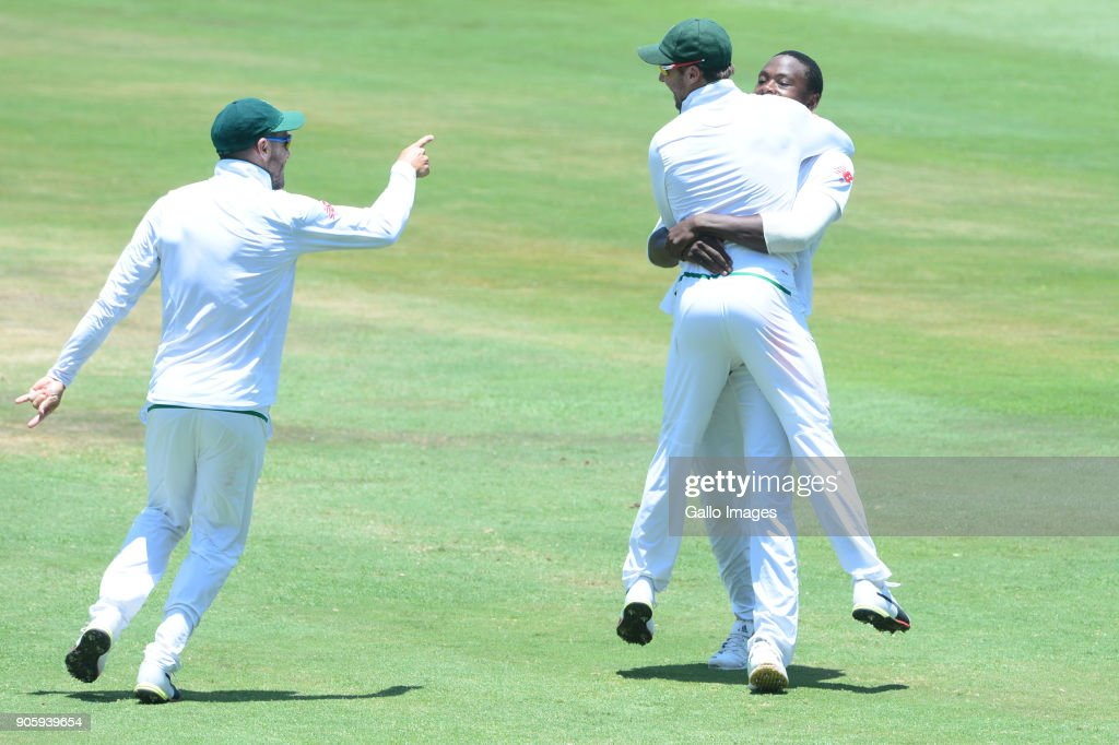 Faf du Plessis, Kagiso Rabada and AB de Villiers of the Proteas celebrate the wicket of Rohit Sharma of India during day 5 of the 2nd Sunfoil Test match between South Africa and India at SuperSport Park on January 17, 2018 in Pretoria, South Africa.