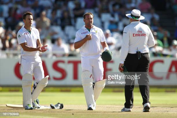 Faf du Plessis of South Africa and Jaques Kallis of South Africa question umpire Steve Davis during day 2 of the 2nd Sunfoil Test match between South...