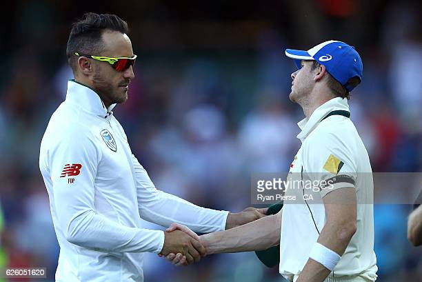 Faf du Plessis of South Africa and Steve Smith of Australia shake hands after day four of the Third Test match between Australia and South Africa at...