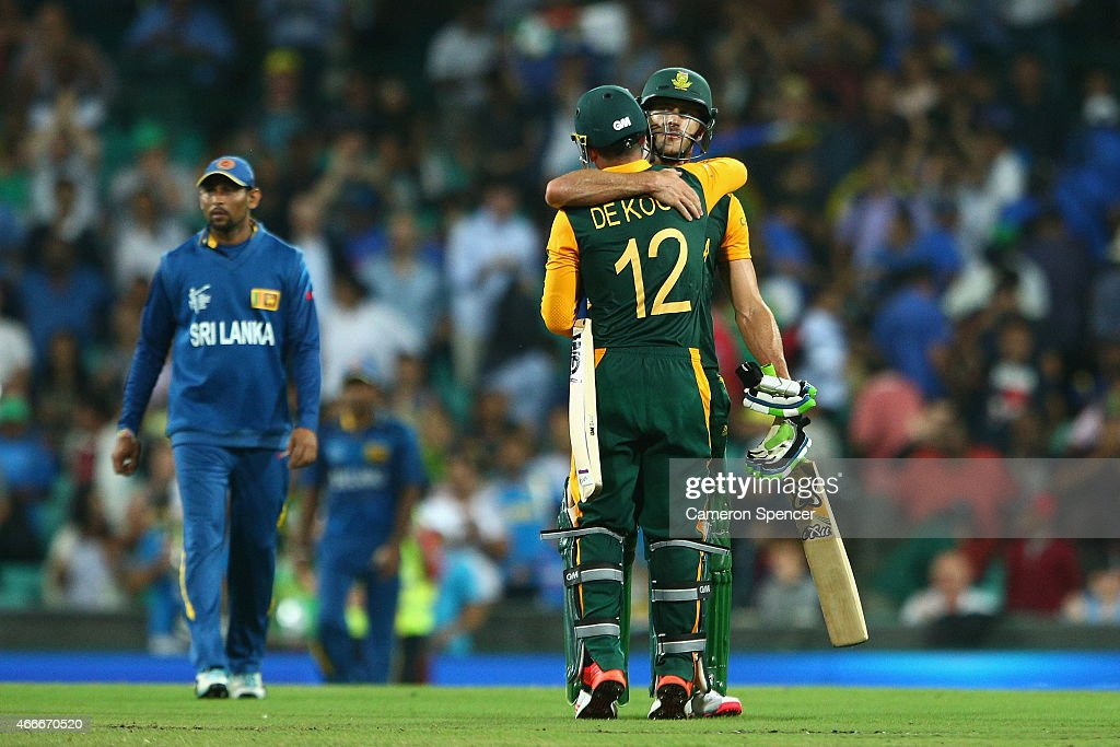 Faf du Plessis of South Africa and team mate Quinton de Kock embrace after winning the 2015 ICC Cricket World Cup match between South Africa and Sri Lanka at Sydney Cricket Ground on March 18, 2015 in Sydney, Australia.