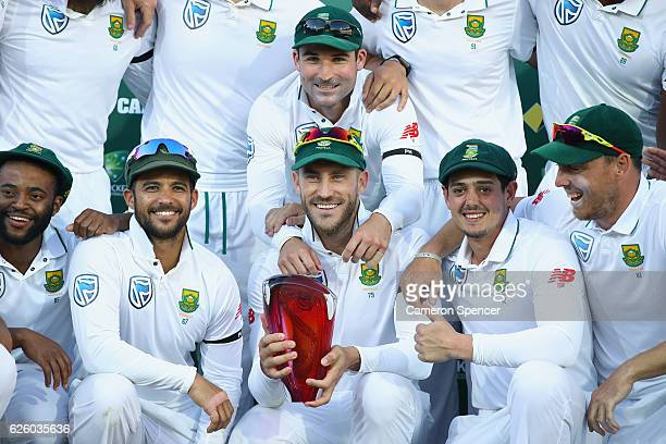 Faf du Plessis of South Africa and the South African team celebrate after winning the series 21 during day four of the Third Test match between...