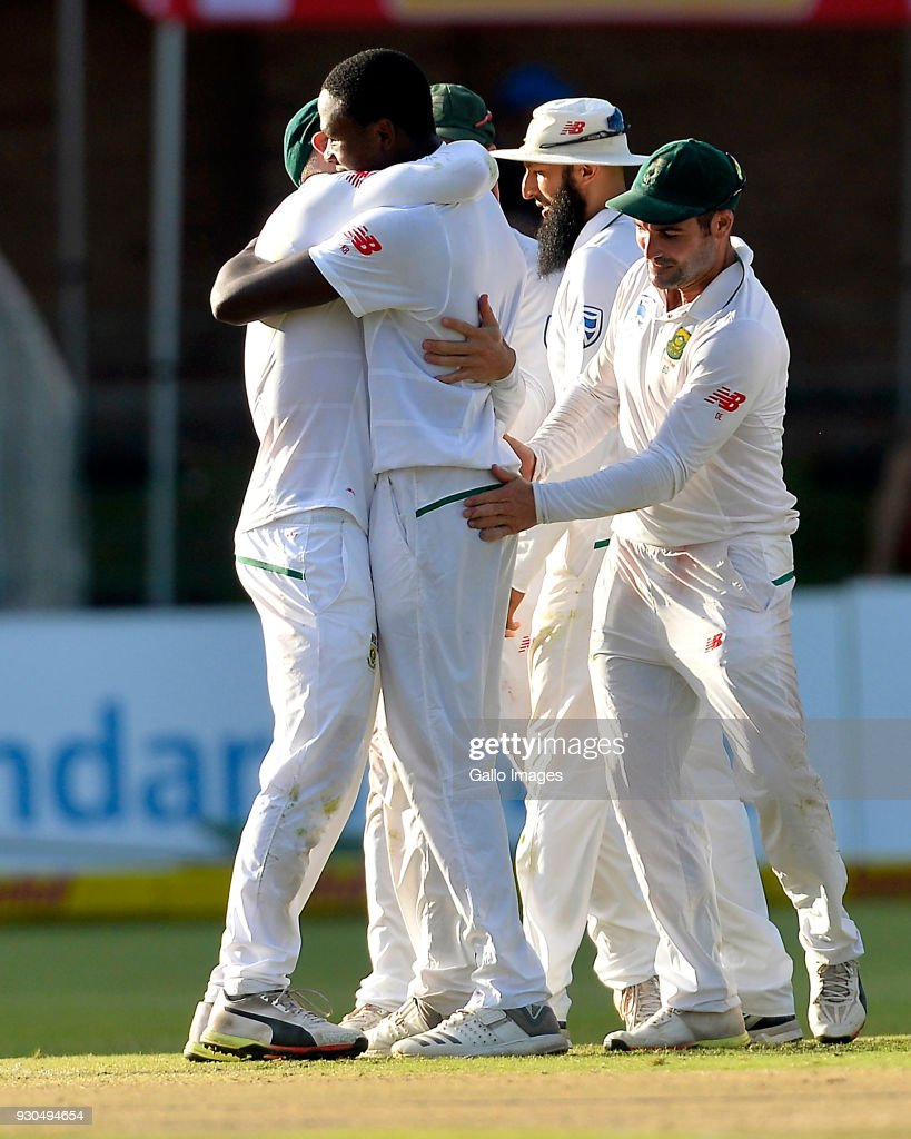 Faf du Plessis (capt) of South Africa celebrate with Kagiso Rabada of South Africa after taking the wicket of Usman Khawaja of Australia during day 3 of the 2nd Sunfoil Test match between South Africa and Australia at St Georges Park on March 11, 2018 in Port Elizabeth, South Africa.