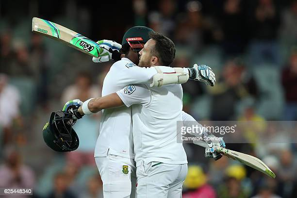 Faf du Plessis of South Africa celebrates with team mate Kagiso Rabada of South Africa after scoring a century during day one of the Third Test match...