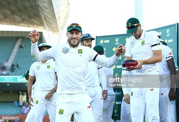 Faf du Plessis of South Africa celebrates with the series trophy during day four of the Third Test match between Australia and South Africa at...