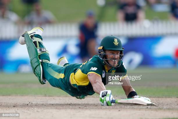 Faf du Plessis of South Africa dives to make the crease during game four of the One Day International series between New Zealand and South Africa at...