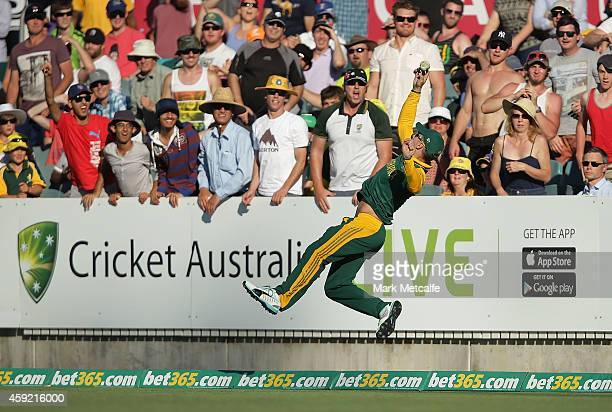Faf du Plessis of South Africa dives to stop a six during game three of the One Day International Series between Australia and South Africa at Manuka...
