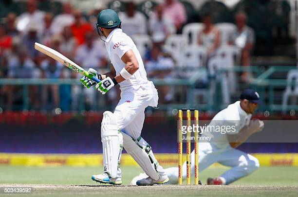 Faf du Plessis of South Africa edges it to Ben Stokes of England who catches him out off the bowling of James Anderson of England during day four of...