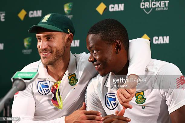 Faf du Plessis of South Africa embraces Kagiso Rabada at a press conference after defeating Australia during day five of the First Test match between...