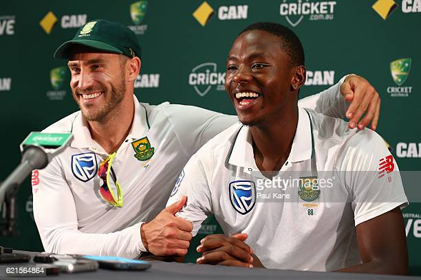 Faf du Plessis of South Africa embraces Kagiso Rabada at apress conference after defeating Australia during day five of the First Test match between...