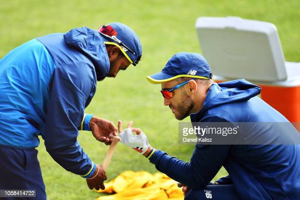 Faf du Plessis of South Africa has his finger taped up during a South Africa ODI training session/press conference at Park 25 on November 7 2018 in...