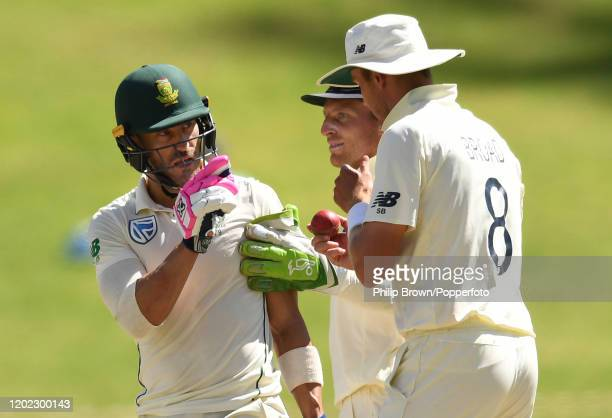 Faf du Plessis of South Africa has words with Stuart Broad and Jos Buttler of England during Day Four of the Fourth Test at the Wanderers between...