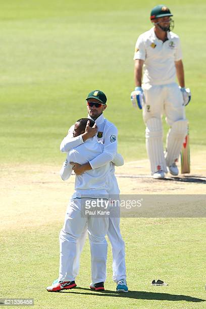 Faf du Plessis of South Africa hugs Temba Bavuma after running out David Warner of Australia during day four of the First Test match between...