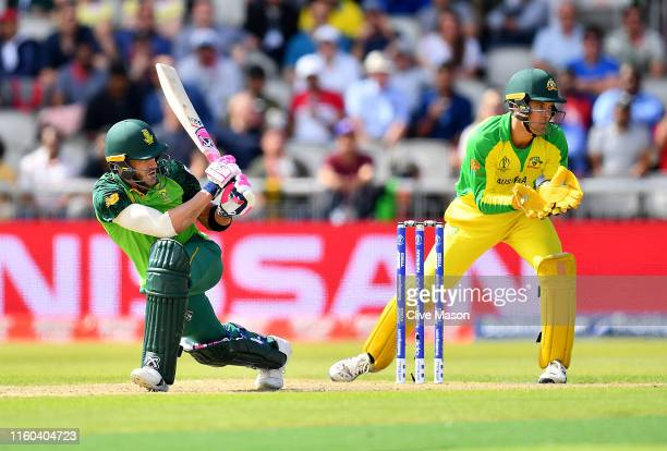 Faf du Plessis of South Africa in action batting as Alex Carey of Australia looks on during the Group Stage match of the ICC Cricket World Cup 2019...