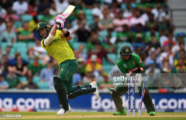 Faf Du Plessis of South Africa is bowled by Mehedi Hasan of Bangladesh as Mushfiqur Rahim of Bangladesh looks on during the Group Stage match of the...