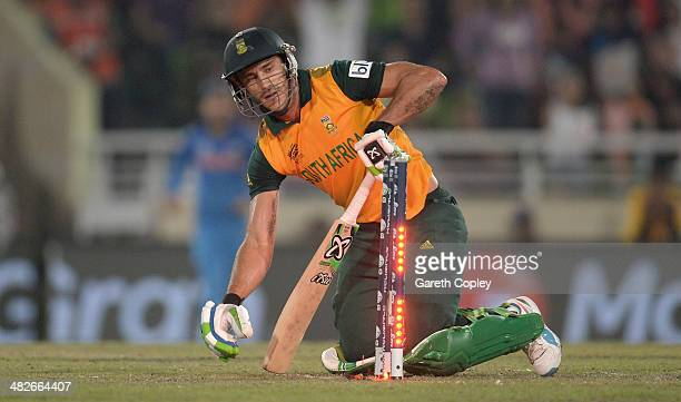 Faf du Plessis of South Africa is bowled by R Ashwin of India during the ICC World Twenty20 Bangladesh 2014 semi final between India and South Africa...