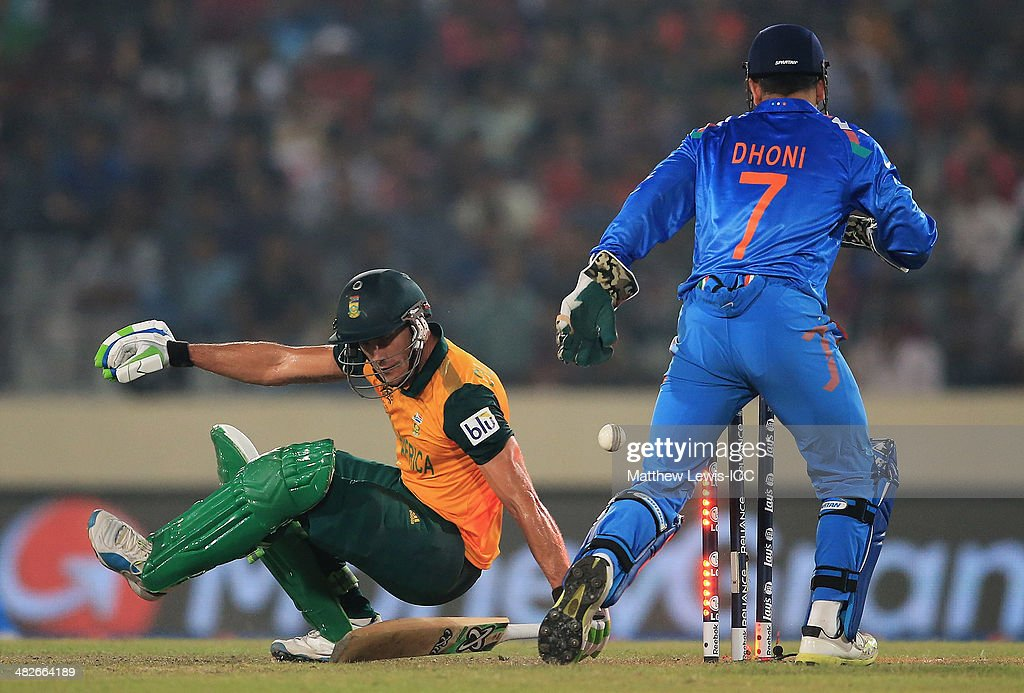 Faf du Plessis of South Africa is bowled by Ravichandran Ashwin of India, as MS Dhoni looks on during the ICC World Twenty20 Bangladesh 2014 Semi Final match between India and South Africa at Sher-e-Bangla Mirpur Stadium on April 4, 2014 in Dhaka, Bangladesh.