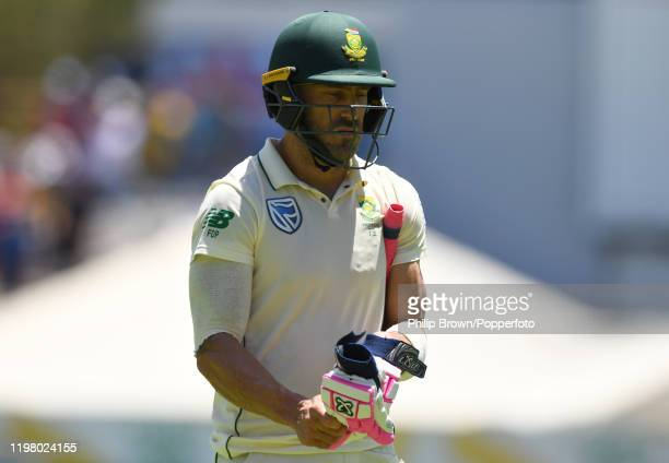 Faf du Plessis of South Africa leaves the field after being dismissed during Day 5 of the Second Test between England and South Africa at Newlands on...