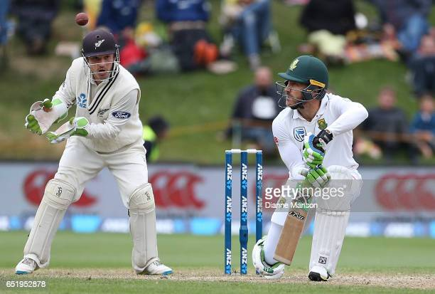 Faf du Plessis of South Africa plays a delivery as BJ Watling of New Zealand keeps wicket during day four of the First Test match between New Zealand...