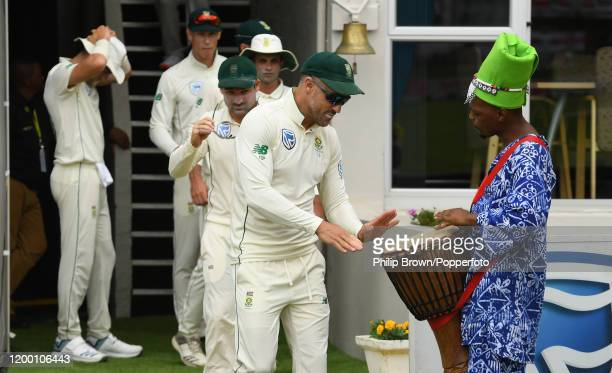 Faf du Plessis of South Africa plays a drum before going on to the field before Day Two of the Third Test between England and South Africa on January...