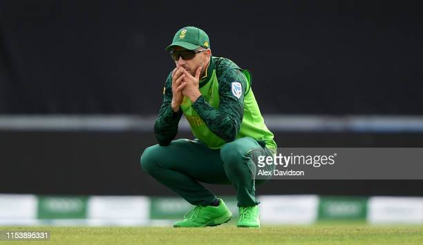 Faf du Plessis of South Africa reacts after David Miller of South Africa drops a catch off Rohit Sharma during the Group Stage match of the ICC...