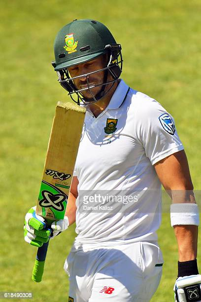 Faf du Plessis of South Africa reacts after scoring his century and walks off the field retired during the Tour match between South Australia and...