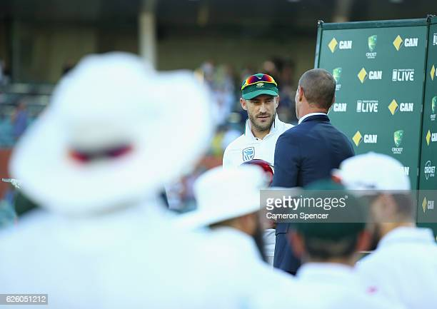Faf du Plessis of South Africa receives the trophy for winning the series during day four of the Third Test match between Australia and South Africa...