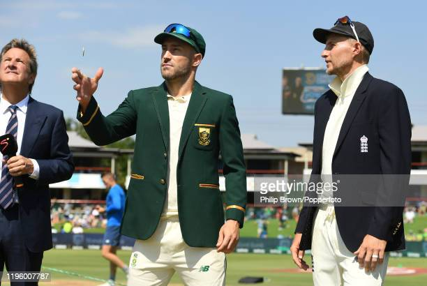 Faf du Plessis of South Africa tosses the coin watched by Joe Root of England before Day One of the First Test match between South Africa and England...