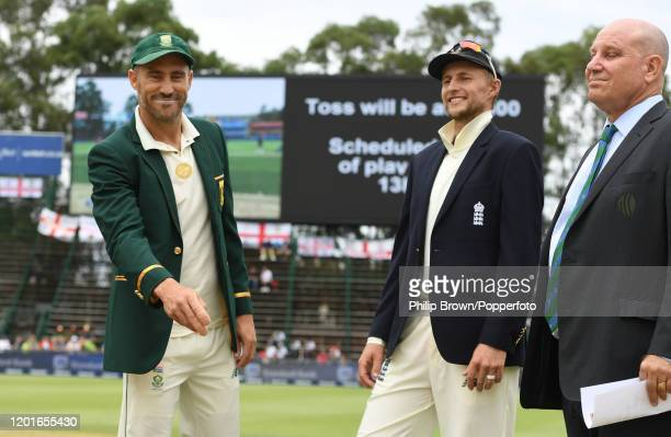 Faf du Plessis of South Africa tosses the coin watched by Joe Root of England on the field before Day One of the Fourth Test between England and...