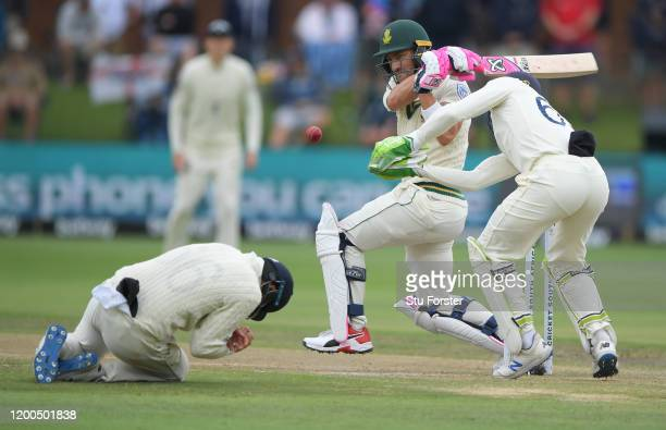 Faf du Plessis of South Africa tucks into a short ball as England captain Joe Root takes evasive action and Jos Buttler looks on during Day Four of...