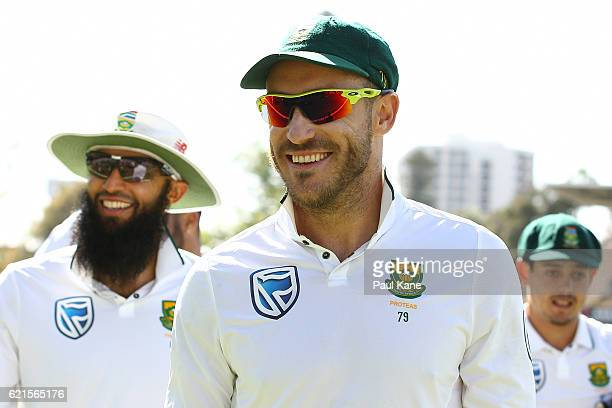 Faf du Plessis of South Africa walks from the field after defeating Australia during day five of the First Test match between Australia and South...