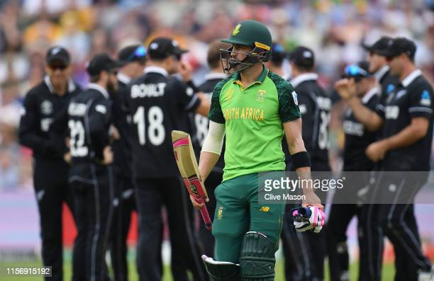 Faf du Plessis of South Africa walks off the field after being bowled by Lockie Ferguson of New Zealand during the Group Stage match of the ICC...