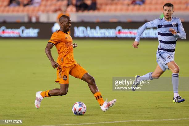 Fafa Picault of Houston Dynamo drives to the goal alongside Ilie Sanchez of Sporting Kansas City during the second half at BBVA Stadium on May 12,...