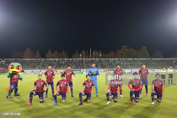 Fagiano Okayama players line up for the team photos prior to the J.League Meiji Yasuda J2 match between Fagiano Okayama and Tochigi SC at the City...