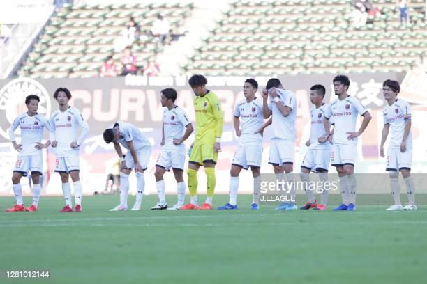 Fagiano Okayama players show their dejection after the J.League Meiji Yasuda J2 match between Fagiano Okayama and Omiya Ardija at the City Light...