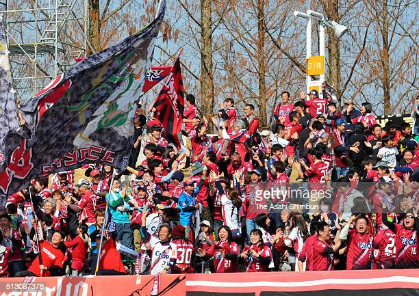 Fagiano Okayama supporters celebrate their team's first goal during the JLeague second division match between Renofa Yamaguchi and Fagiano Okayama at...