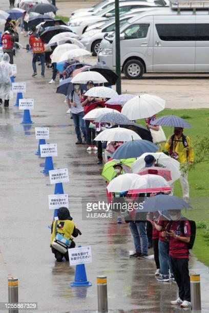 Fagiano Okayama supporters queue with keeping social distances prior to the J.League Meiji Yasuda J2 match between Fagiano Okayama and Giravanz...