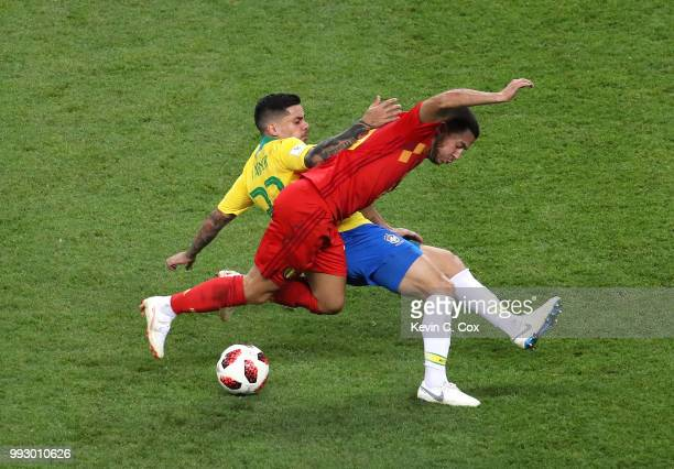 Fagner of Brazil tackles Eden Hazard of Belgium during the 2018 FIFA World Cup Russia Quarter Final match between Brazil and Belgium at Kazan Arena...