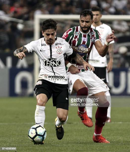 Fagner of Brazils Corinthians vies for the ball with Henrique Dourado of Brazils Fluminense during their 2017 Brazilian championship football match...
