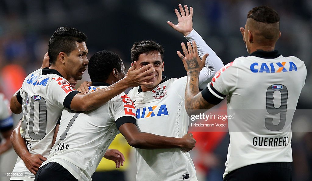 Fagner (2R) of Corinthians celebrates scoring the second goal during the match between Corinthians and Internacional for the Brazilian Series A 2014 at Arena Corinthians on July 17, 2014 in Sao Paulo, Brazil.