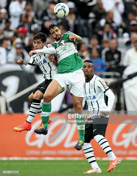 Fagner of Corinthians fights for the ball with Henrique of Palmeiras during the match between Corinthians and Palmeiras for the Brazilian Series A...